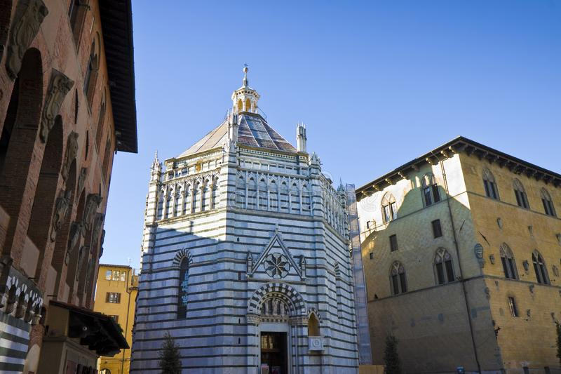 Saint John`s baptistery in Pistoia city built in the year 1303 with an octagonal base - On the left the Episcopal Palace Tuscany. Italy royalty free stock photography