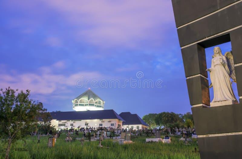 Saint Joseph's Cathedral Kuching Malaysia. A sunrise view of the graveyard at Saint Joseph's Cathedral or church Kuching Malaysia royalty free stock photography