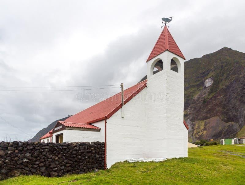 Saint Joseph`s Catholic church, Edinburgh of the Seven Seas town, Tristan da Cunha. A whale and cardinal direction pointer signs royalty free stock photos