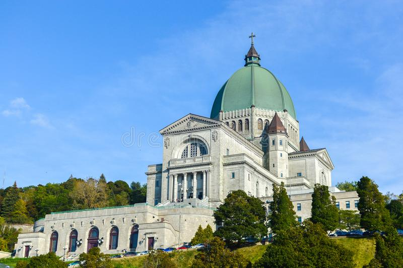 Saint Joseph`s Oratory of Mount Royal located in Montreal. Is Canada`s largest church and the Canadian flag royalty free stock images