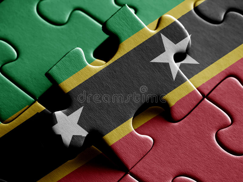 Saint Kitts and Nevis FLAG PAINTED ON PUZZLE nice royalty free illustration