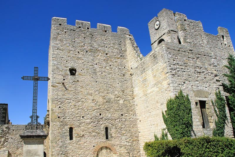 Saint - Laurent des Arbres, Provencal village in the south of F. Church of Saint-Laurent des Arbres, fortified by high walls equipped with battlements and a stock photography