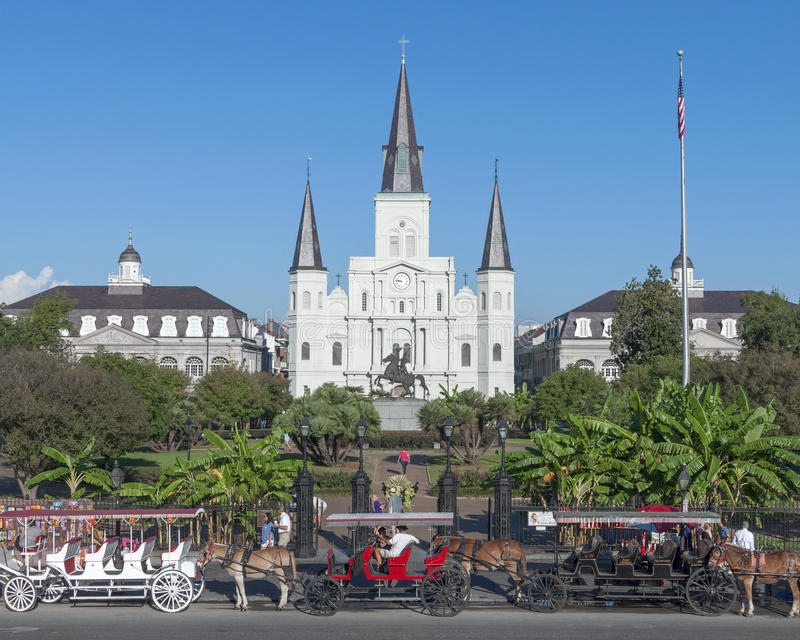 Saint Louis Cathedral, New Orleans. NEW ORLEANS, USA - OCTOBER 11, 2014: Horse-drawn carriages are lined up on street in front of Saint Louis Cathedral in New royalty free stock photo