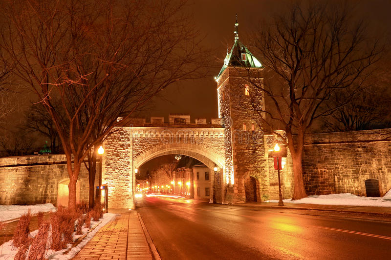 Saint Louis Gate at night, Quebec, Canada. Located in Canada, the Ramparts of Quebec City are the only remaining fortified city walls in North America north of stock photography
