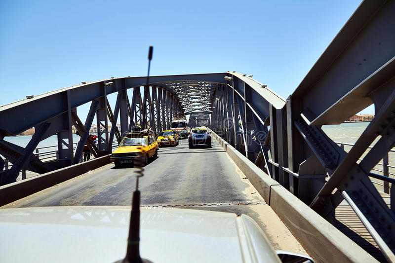 Saint-Louis, Senegal opened Faidherbe bridge spans the Senegal river linking the island-city of St.-Louis to the royalty free stock photography