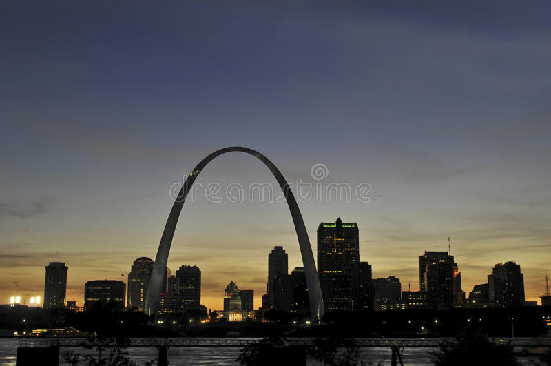 Saint Louis Skyline. With the Mississippi river in front after sunset royalty free stock images