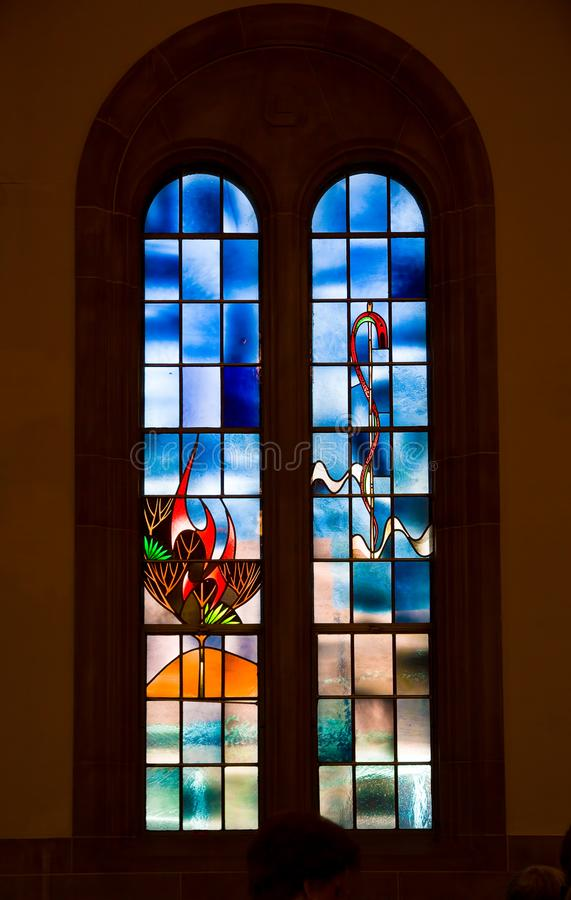 Saint Louis, United States-March 11, 2015: Stained glass window. By Emil Frei Jr. depicting stylized burning bush at Hope United Church of Christ royalty free stock images