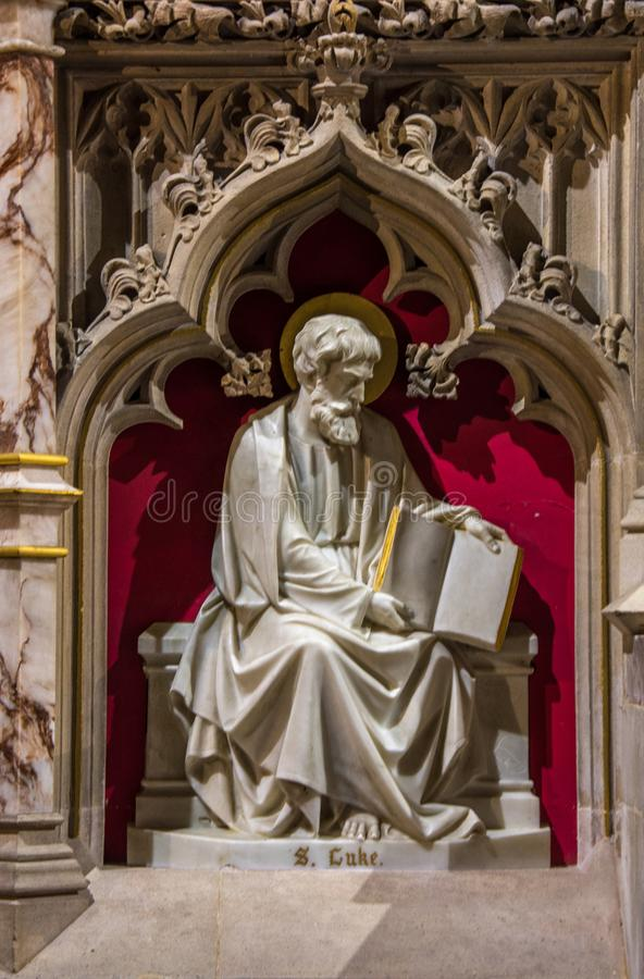 Saint Luke Artwork. Artwork of Saint Luke on the high Altar, in the church of St James. In the market town of Louth Lincolnshire England royalty free stock image