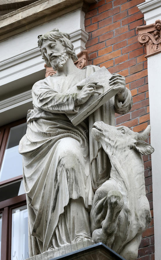 Saint Luke the Evangelist. On the facade of Evangelical School in Vienna, Austria royalty free stock images