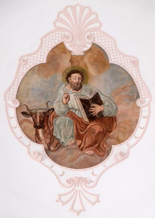 Saint Luke the Evangelist. Fresco in the Church of Assumption of the Virgin Mary in Pokupsko, Croatia royalty free stock photography