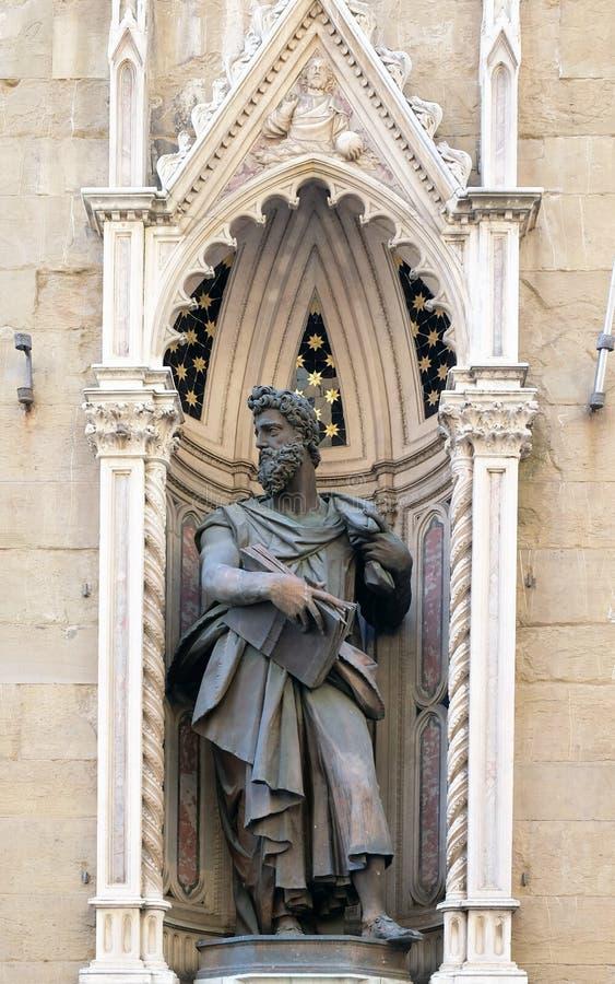 Saint Luke the Evangelist. Saint Luke by Giambologna Orsanmichele Church in Florence, Tuscany, Italy royalty free stock image
