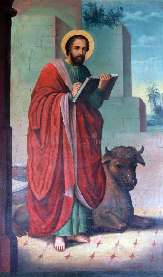 Saint Luke the Evangelist. Painting on pulpit stock photo