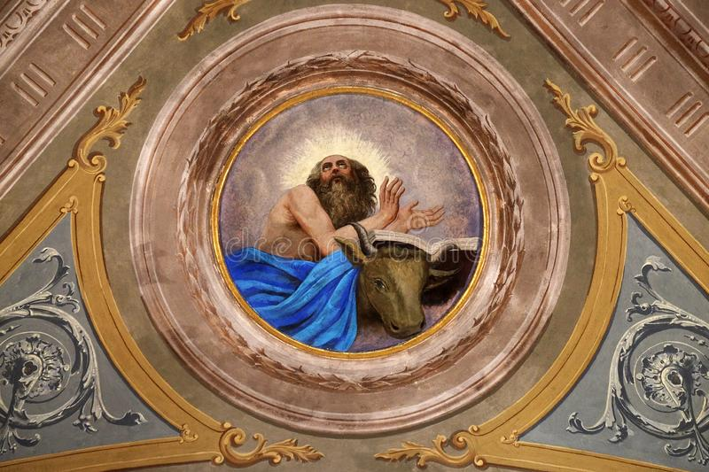 Saint Luke the Evangelist. Ceiling fresco in the church of St. Victor on the Fishermen Island, one of the famous Borromeo Islands of Lake Maggiore, Italy royalty free stock images