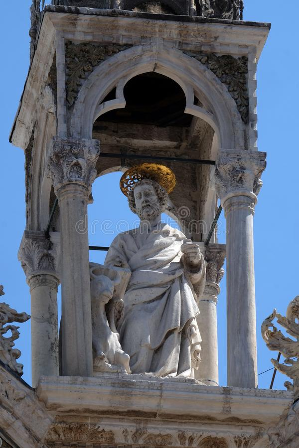 Saint Luke the Evangelist. Marble statue, detail of the facade of the Saint Mark`s Basilica, St. Mark`s Square, Venice, Italy, UNESCO World Heritage Site stock photo