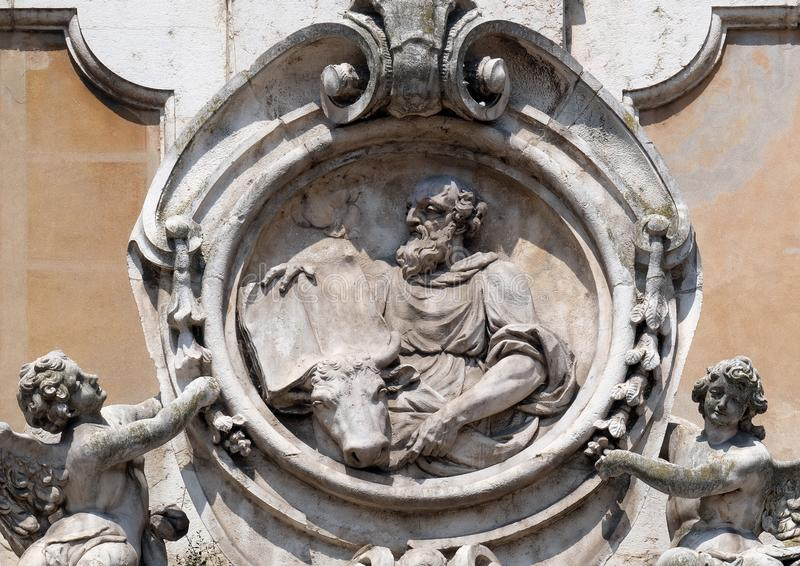 Saint Luke the Evangelist. Statue on facade of the Mantua Cathedral dedicated to Saint Peter, Mantua, Italy royalty free stock photography