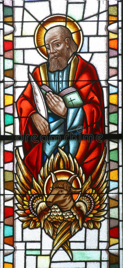 Saint Luke the Evangelist. Stained glass church window stock images