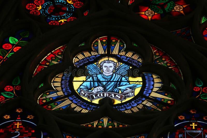 Saint Luke the Evangelist. Stained glass in Votiv Kirche The Votive Church in Vienna, Austria royalty free stock images