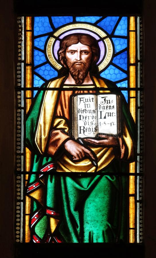 Saint Luke the Evangelist. Stained glass window in parish church of Saint Mark in Zagreb, Croatia stock photos