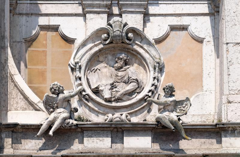 Saint Luke the Evangelist. Statue on facade of the Mantua Cathedral dedicated to Saint Peter, Mantua, Italy stock photo