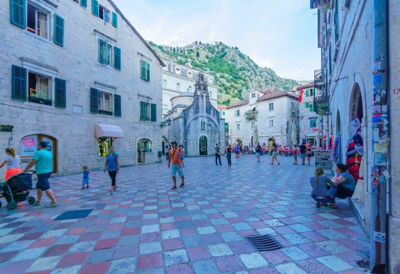 Saint Luke Square, Kotor. KOTOR, MONTENEGRO - JUNE 28, 2015: Scene of the Saint Luke Square and the church of Saint Luke, locals and tourists, in Kotor stock photos