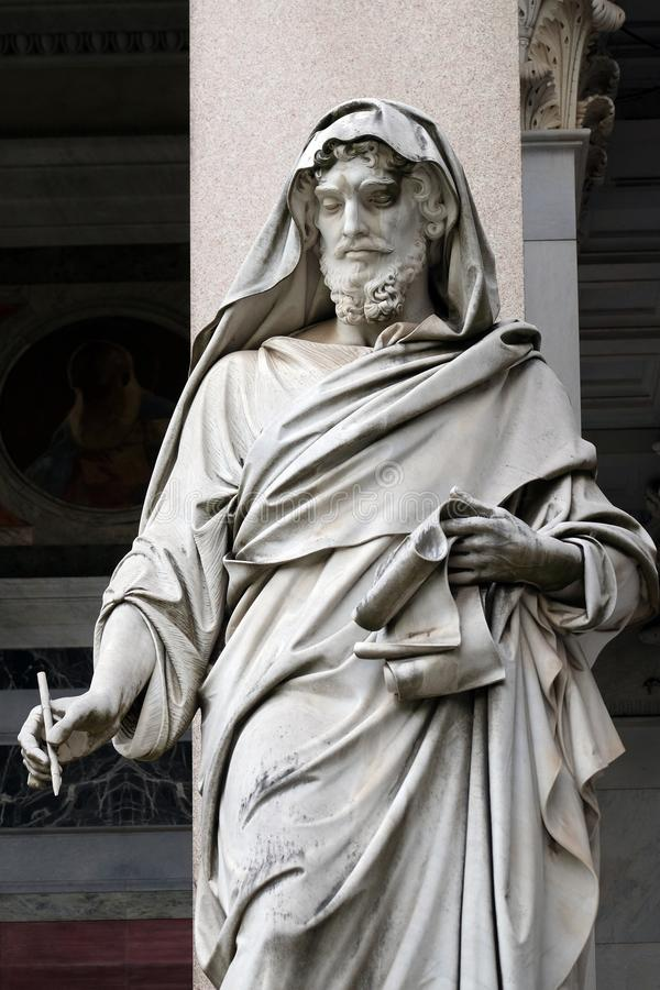 Saint Luke. Statue in front of the basilica of Saint Paul Outside the Walls, Rome, Italy royalty free stock photos