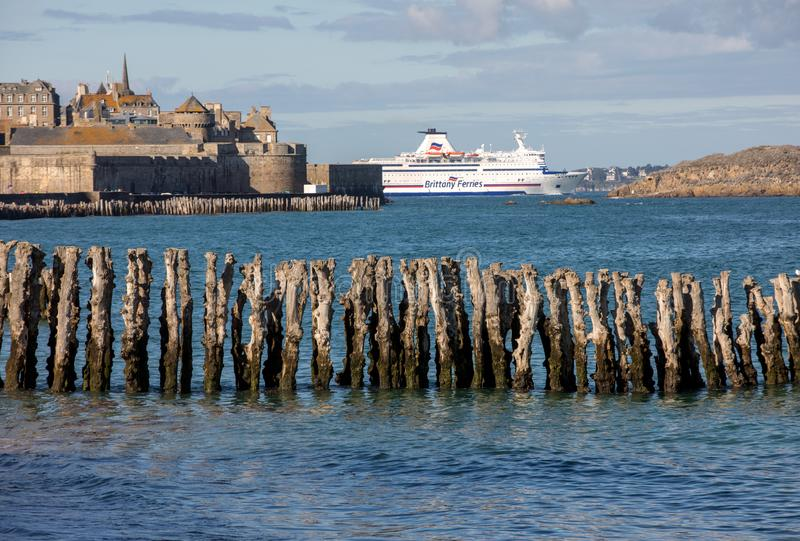 Passenger ferry leaving the port of Saint Malo in the morning in the direction of United Kingdom royalty free stock image