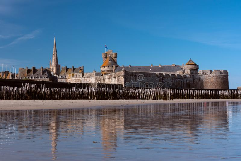 Saint Malo, the ramparts and the old town. The old town and the ramparts of Saint Malo seen from the beach, ancient, architecture, attraction, blue, bretagne stock photos