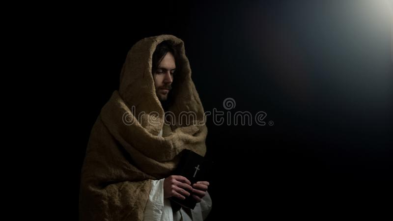Saint man holding holy bible, prophecies for Christians, new testament book stock image