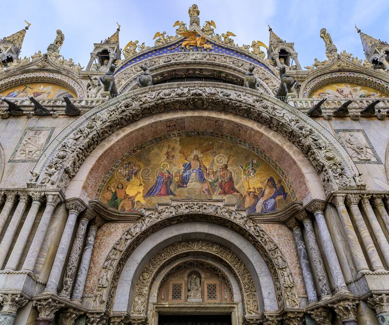 Ornate facade of Saint Mark`s Basilica with mosaics on Saint Mark`s square in Venice Italy. Saint Mark`s Basilica ornate facade mosaics over the main portal royalty free stock image