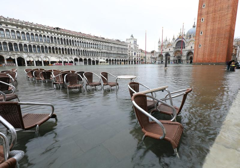 Saint Mark Square in Venice in Italy during the flood. And many chairs in the water stock photos