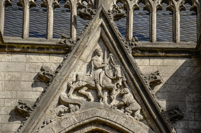 Saint Martin at Dom church, Utrecht, the Netherlands. Detail of Saint Martin sharing his cloak with a beggar. St. Martin of Tours (Latin: Sanctus Martinus stock images