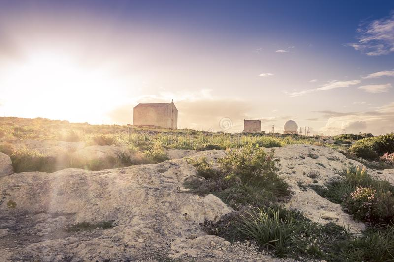 Saint Mary Magdalene Chapel and Aviation radar near Dingli Cliffs, Malta royalty free stock image