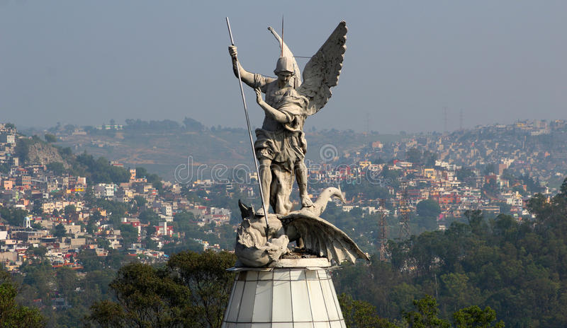 Saint Michael archangel full body sculpture city in the back stock image