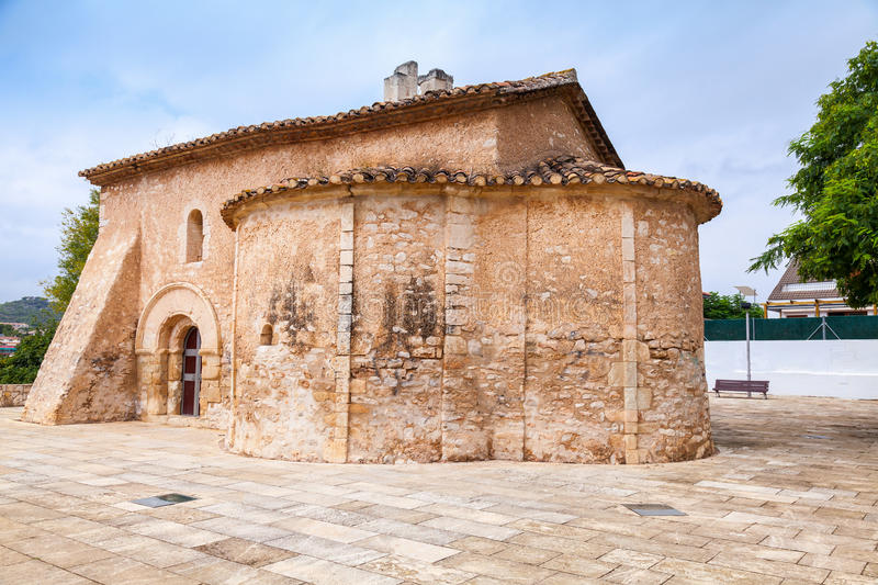 Saint Michael church in Calafell, Spain. It is a work of transaction from Romanic to Gothic style, was shaped in XIII century, has two apses, one consecrated royalty free stock photography