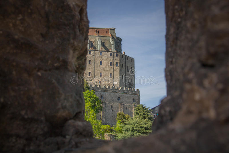 Saint Michael`s Abbey in Val di Susa from San Sepolcro ruins window. Piedmont. Italy. royalty free stock images