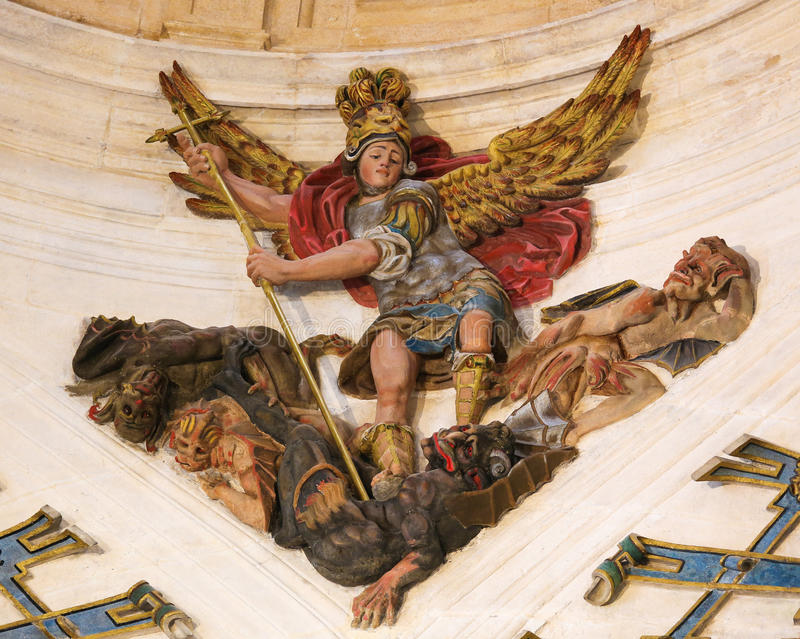 Saint Michael slaying the dragon in Burgos Cathedral royalty free stock photo