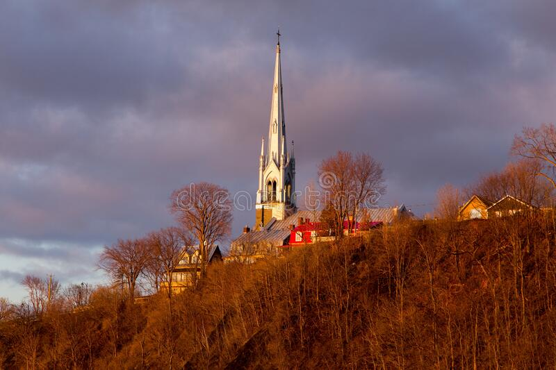 The 1854 Saint-Michel-de-Sillery church dominating a cape seen from the Champlain Boulevard during a beautiful golden hour. Spring morning in the Sillery area stock photo