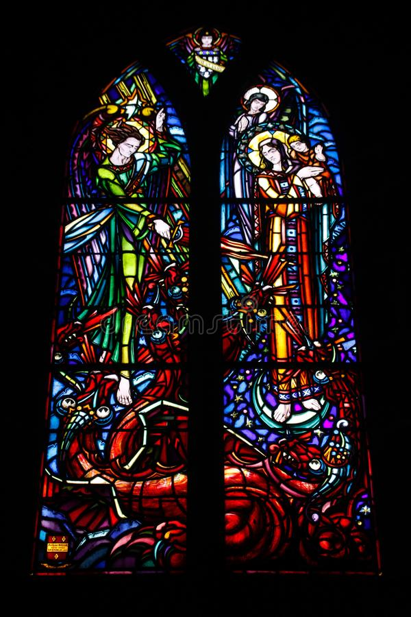 Multicolored beautiful stained glass windows in the main gothic cathedral of France royalty free stock images