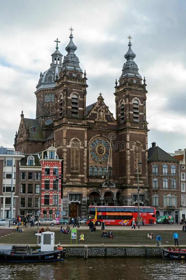 Saint Nicholas Basilica the major Catholic church in Old center District and typical Dutch houses, Amsterdam, The Netherlands, 13 royalty free stock images