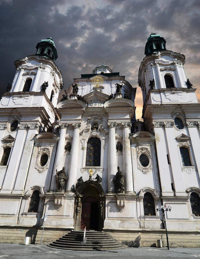 Saint Nicholas Church in Prague with cloudy sky royalty free stock images