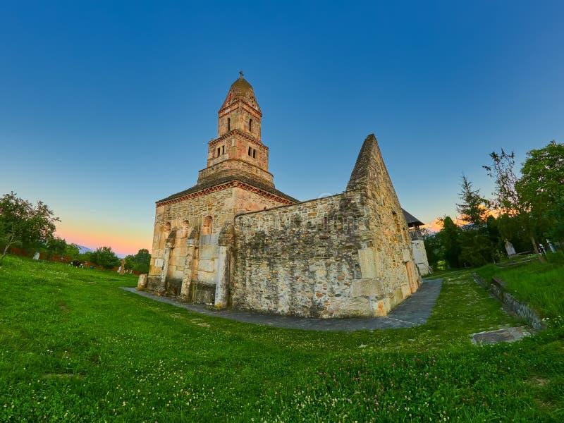 The Saint Nicolae church from Densus, Hunedoara district in Romania stock photography