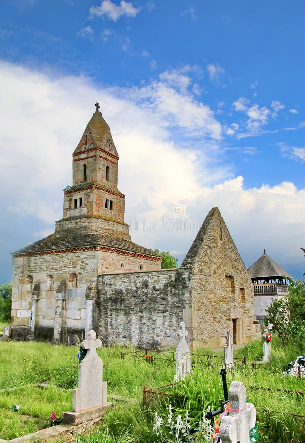 Densus Church Romania. Saint Nicolae`s Orthodox Church from the village of Densus, Hunedoara County is one of the oldest churches still standing in Romania. The stock images