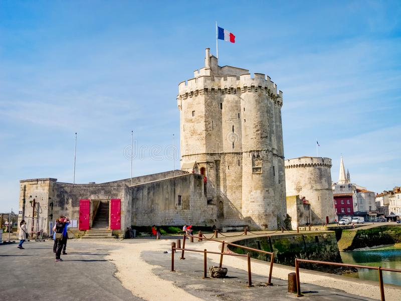 Saint Nicolas and Chain tower in La Rochelle, France. LA ROCHELLE, FRANCE - MARCH 29, 2017: Saint Nicolas and Chain tower in La Rochelle, Charente Maritime, the royalty free stock photo