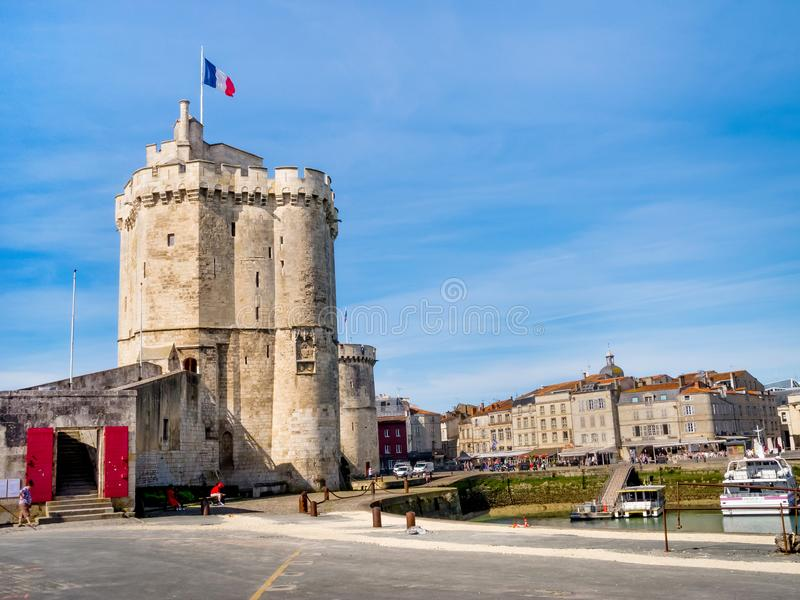 Saint Nicolas and Chain tower in La Rochelle, France. LA ROCHELLE, FRANCE - MARCH 29, 2017: Saint Nicolas and Chain tower in La Rochelle, Charente Maritime, the royalty free stock photos