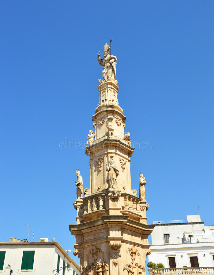 Saint Oronzo statue on baroque column in Ostuni, Apulia, Italy stock images