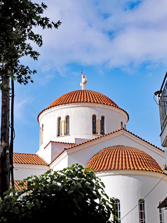 Greek Orthodox Church, Nafpaktos, Greece. Saint Paraskevi, white painted Greek Orthodox Church, Nafpaktos, Greece, Gulf of Corinth, with terracotta tiled domes stock image