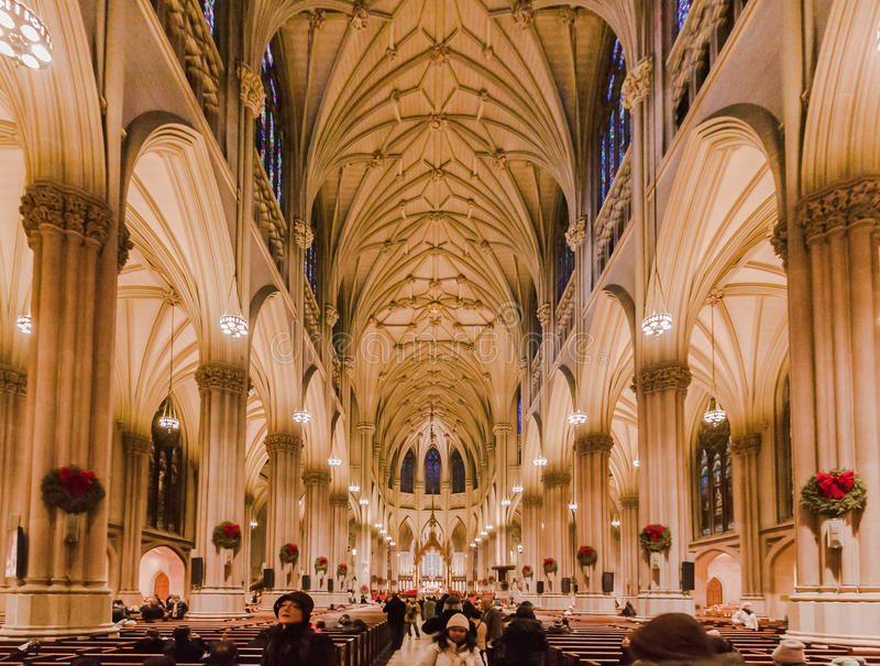 Saint Patrick Cathedral New York City. The main nave of Saint Patrick Cathedral with its long columns and arches in Fifth Avenue, Manhattan Island, New York City stock images