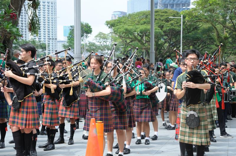 Saint Patrick`s Day Bagpipe Music Band. On parade. Event in Singapore on 18th March 2018 Sunday along the Singapore River stock images