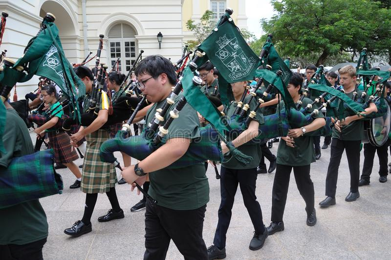 Saint Patrick`s Day Bagpipe Music Band. On parade. Event in Singapore on 18th March 2018 Sunday along the Singapore River stock image