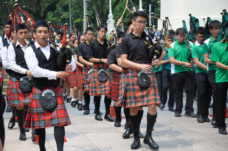 Saint Patrick`s Day Bagpipe Music Band. On parade. Event in Singapore on 19th March 2017 Sunday along the Singapore River royalty free stock photos